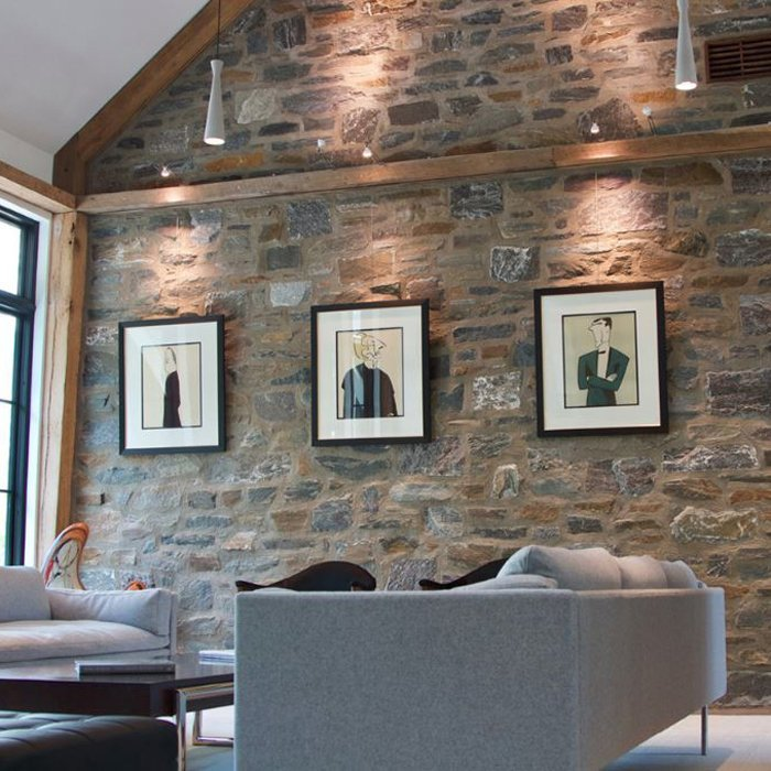 3framed picture hung in a straight row on a stone wall